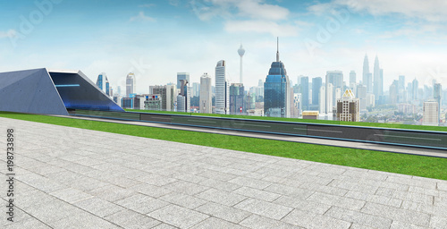 Foto op Canvas Kuala Lumpur Empty asphalt road with tunnel ,greenfield and modern city skyline background . Mixed media .