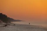 Beach during sunrise fog