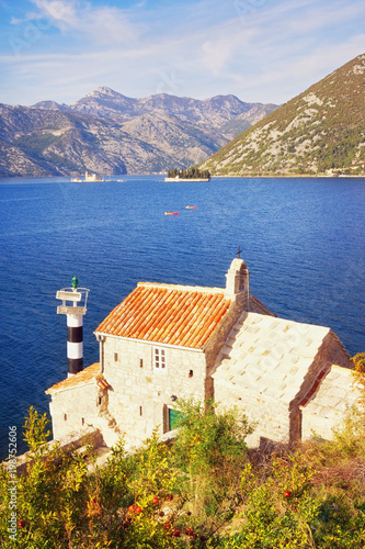 Foto op Canvas Beige Sunny autumn day. Montenegro . View of Bay of Kotor, church of Our Lady of the Angels and two islands - Our Lady of the Rocks and St. George