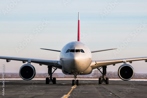 Fototapeta Wide-bodied passenger aircraft on the main taxiway