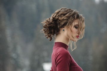 Woman with curly hairstyle at winter © antgor