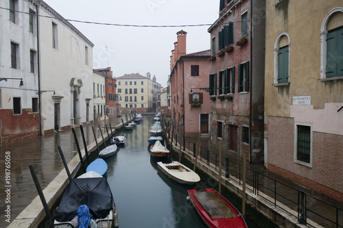 Canal with boats in Venice - 198765058