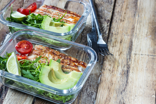 Healthy meal prep containers with rukola, turkey grill, tomatoes and avocado - 198770058