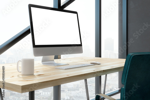 Contemporary office with empty white computer screen
