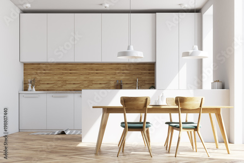 White and wooden kitchen with a table