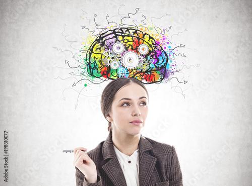 Pensive businesswoman with a pen, cog brain © denisismagilov