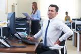 Businessman Working At Desk Suffering From Backache - 198814814