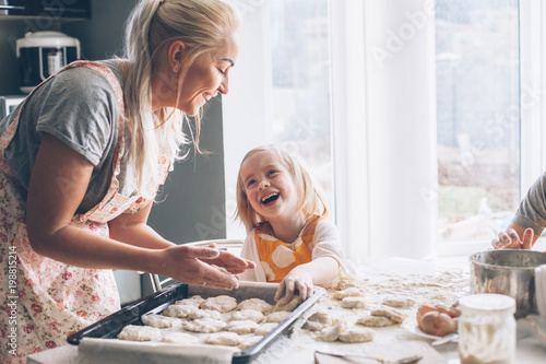 Mom cooking with daughter on the kitchen - 198815214