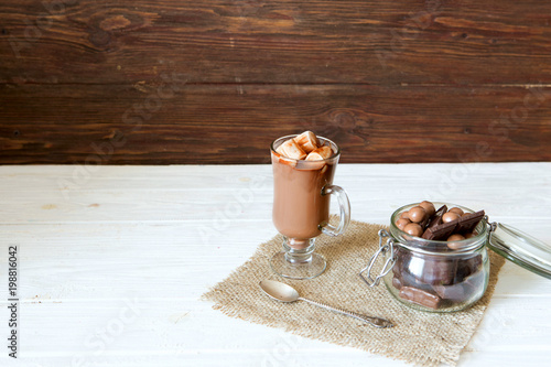 Foto op Canvas Milkshake Chocolate smoothie with marshmallows on a rustic wooden background