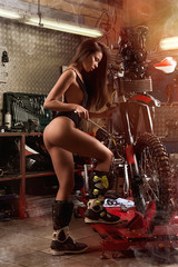 Sexy girl repairing motorcycle