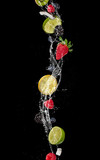 Pieces of fruit in water splash, isolated on black background - 198822807