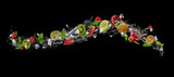 Pieces of fruit in water splash, isolated on black background - 198822853