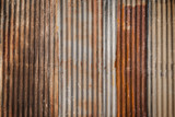 Rusty and corrugated iron metal construction site wall texture background with vignette. - 198828478