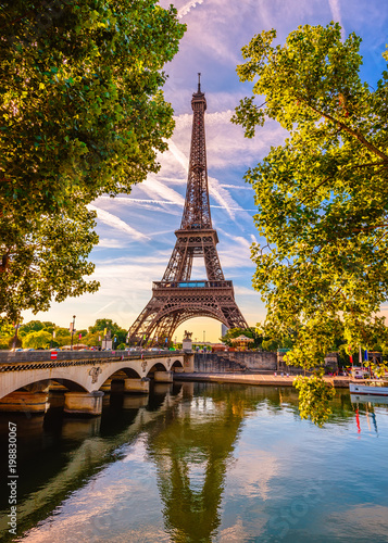 Leinwanddruck Bild Paris Eiffel Tower and river Seine in Paris, France. Eiffel Tower is one of the most iconic landmarks of Paris
