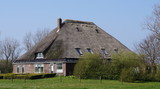 Farmhouse in a shape typically found in the province of North Holland in the Netherlands. This type of farmhouse is called a Stolpboerderij in Dutch.