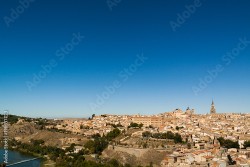 Foto Murales Panoramic of Toledo, with blue sky. Castilla la Mancha. Spain