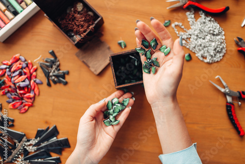 Foto Murales Female hands holds needlework accessories top view