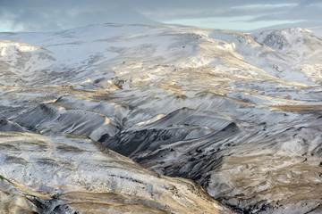 Snow-covered mountains in Winter. Near Selfoss, Iceland.