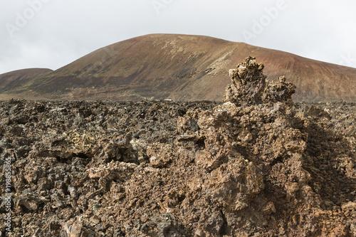 Fotobehang Canarische Eilanden Lava Fields In Lanzarote, Spain