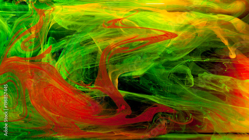 Abstraction of mix multicolored paints in water on a black background - 198857445
