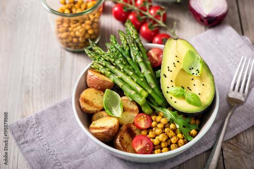 Fotobehang Boeddha Healthy dinner with baked potatoes, green asparagus and spicy chickpeas, avocado, arugula, vegan, vegetarian food