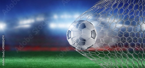 Football ball in the net of a goal - 3d rendering