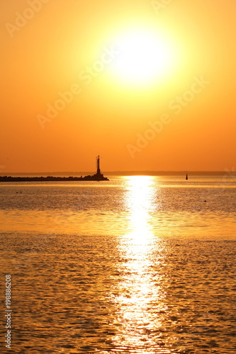 Fotobehang Zee zonsondergang Orange sun over the sea horizon, beautiful sunset, copy space, landscape with a big sun, bloody horizon above the water surface, blank for the designer, orange pattern