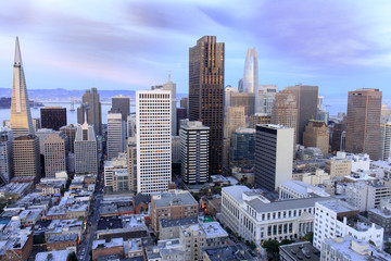 San Francisco Financial District view from above. Aerial view of San Francisco Financial District as seen from a building rooftop in Nob Hill at dusk.