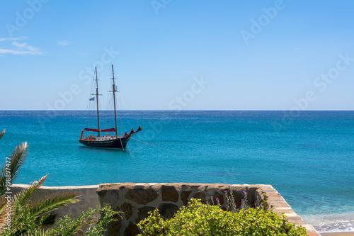 Foto op Plexiglas Schip View of ship on blue sea in Paleochori bay on Milos island in Greece.