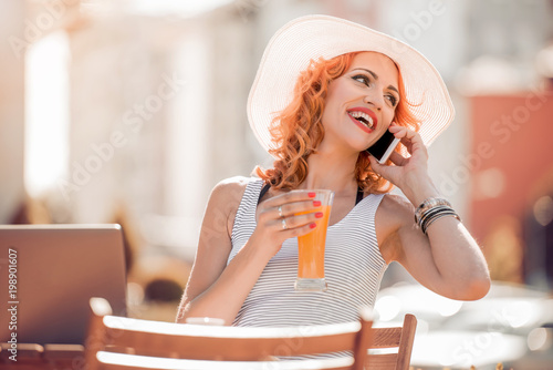 Beautiful woman talking on her cellphone at restaurant
