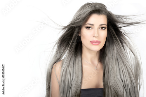 Young woman with long trendy silver hair