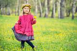 Portrait of little girl on a flower field - 198925410