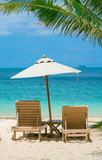 comfortable chair on the beach, modern umbrella, clear sky and sea, copy space.