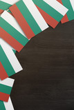 Bulgaria small flags framing a wood texture background with copy space - 198934862