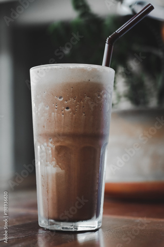 Foto Murales Cold coffee drink frappe on wood table