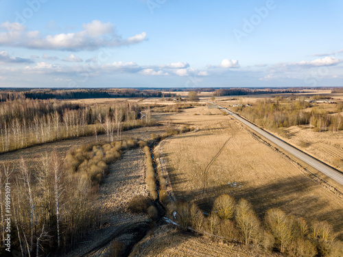 Fotobehang Blauwe hemel drone image. aerial view of rural area with houses and road network. populated area Dubulti near Jekabpils, Latvia