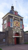 Historical building in the city of Delft in the Netherlands. The building was used to store gunpowder outside the city walls, in Dutch the building is called the Kruithuis, meaning gunpowder storage.