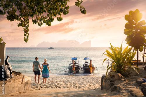 Couple on the tropical sunset beach