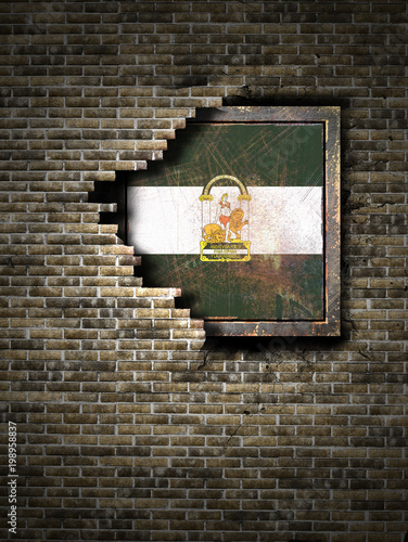 Old Andalusia flag in brick wall
