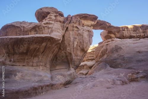 Fotobehang Lavendel Wadi Ram desert stone bridge. Jordan landscape. Rock arch.