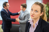 Unhappy Businesswoman With Male Colleague Being Congratulated - 198965402