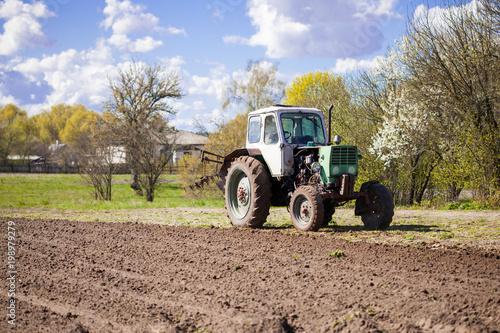 Fotobehang Trekker The tractor plows the earth