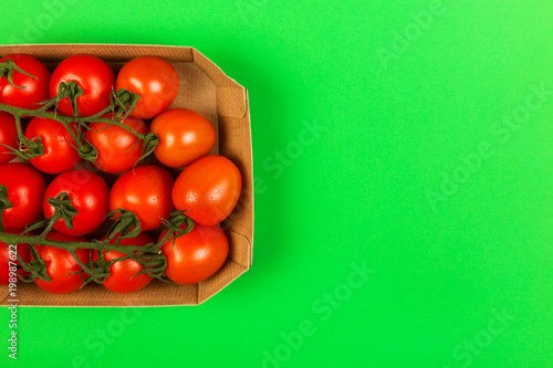 Red cherry tomatoes on green background. Top view, copy space. Food background - 198987622