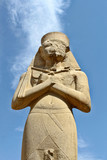 Carved statue of pharaoh Ramses II situated at Karnak Temple