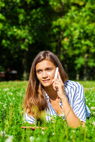 Portrait of beautiful caucasian smiling brunette young woman calling by phone