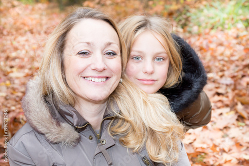 cheerful blonde family single mother with cute blond daughter