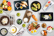 Set of different breakfasts on white  table. Fruits, croissants, apples, honey, coffee, curd, cheese, porridge, bread, english breakfast, avocado, semolina, eggs, sandwiches, granola, muesli, yogurt.