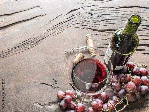 Wine glass, wine bottle and grapes on wooden background. Wine tasting. - 199028232