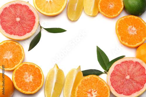 healthy food. mix sliced lemon, green lime, orange, mandarin and grapefruit with green leaf isolated on white background. top view with copy space - 199033017