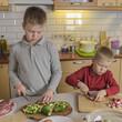 children make a salad of vegetables - 199036866